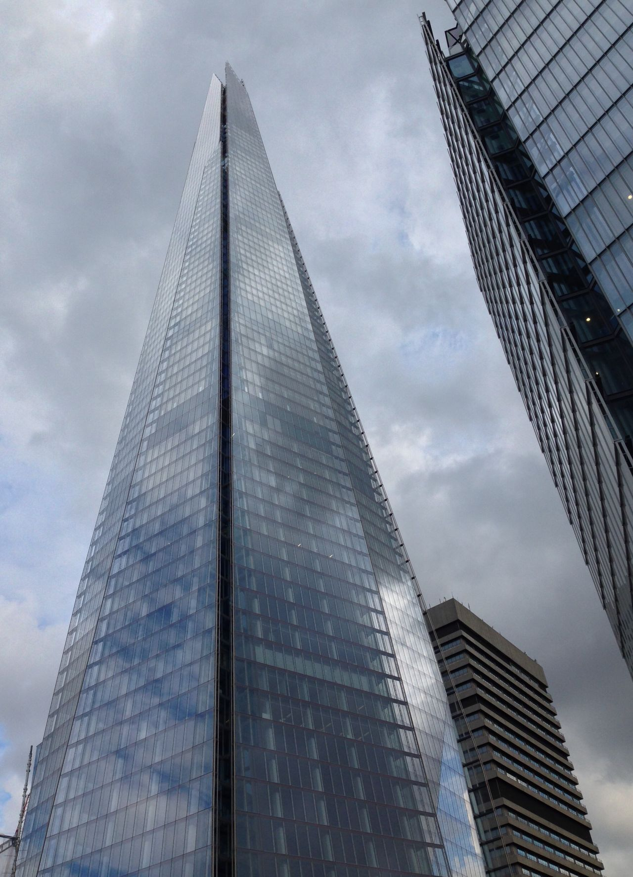 The Shard London. London Lifestyle Architecture Low Angle View Built Structure Sky Building Exterior Skyscraper Modern City Reflection Cloud - Sky Tower Outdoors Day No People Tall EyeEm Best Shots Famous Places The Shard, London Architecture London Landmarks London Architecture Capital Cities  EyeEm Gallery London