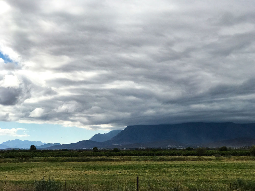 Storm blowing in Beauty In Nature Clouds Day Field Grass Landscape Mountain Mountain Range Nature No People Outdoors Scenics Sky Stormy Weather Tranquil Scene Tranquility