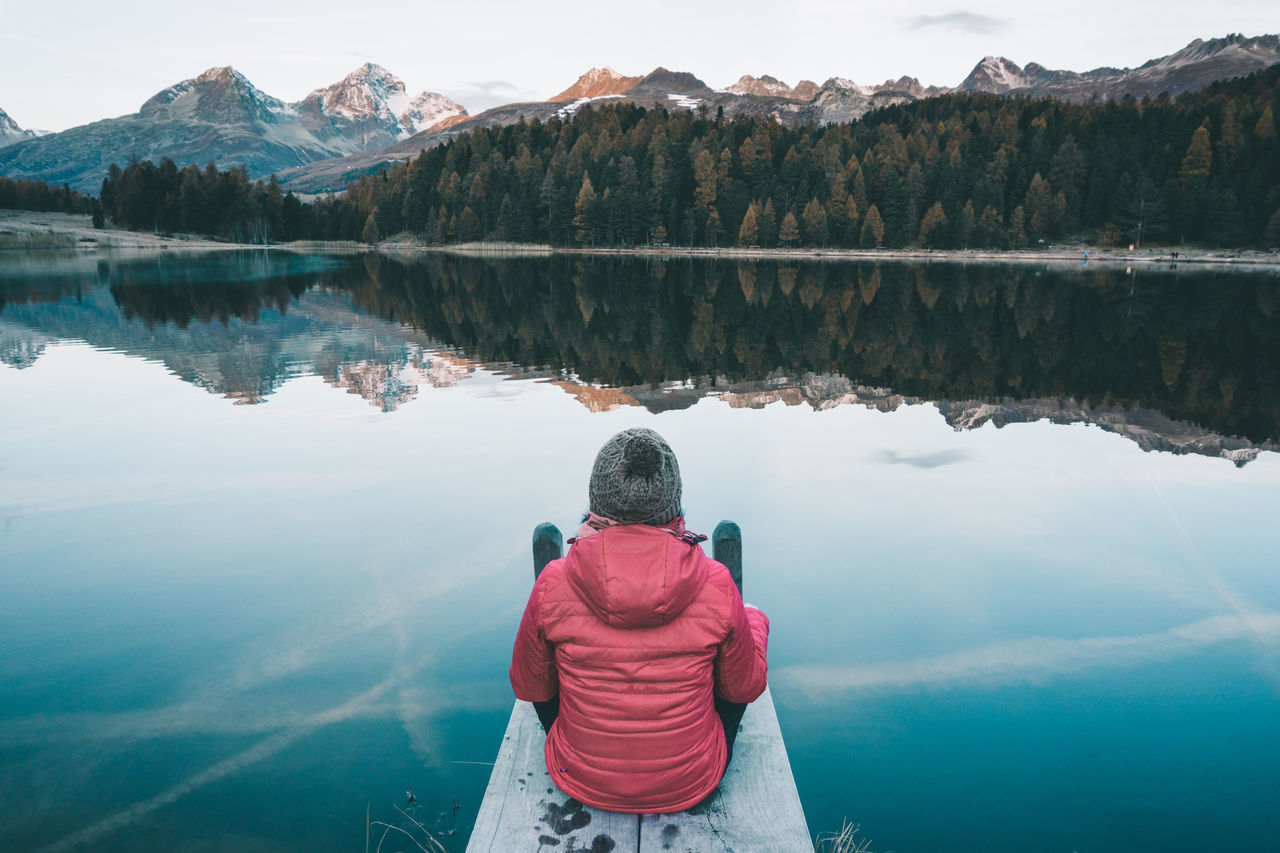 Girl sitting at the mountain lake on a clear and cold morning in autumn Adventure Graubünden Jetty Lake Landscape Love Mountain Reflection Mountains Nature Outdoor Woman Outdoors Peaceful Postcard Reflection Schweiz Sitting At Lake St. Moritz Suisse  Suit Swiss Alps Switzerland Switzerlandpictures Trees Wallpaper Women Fresh On Market 2017