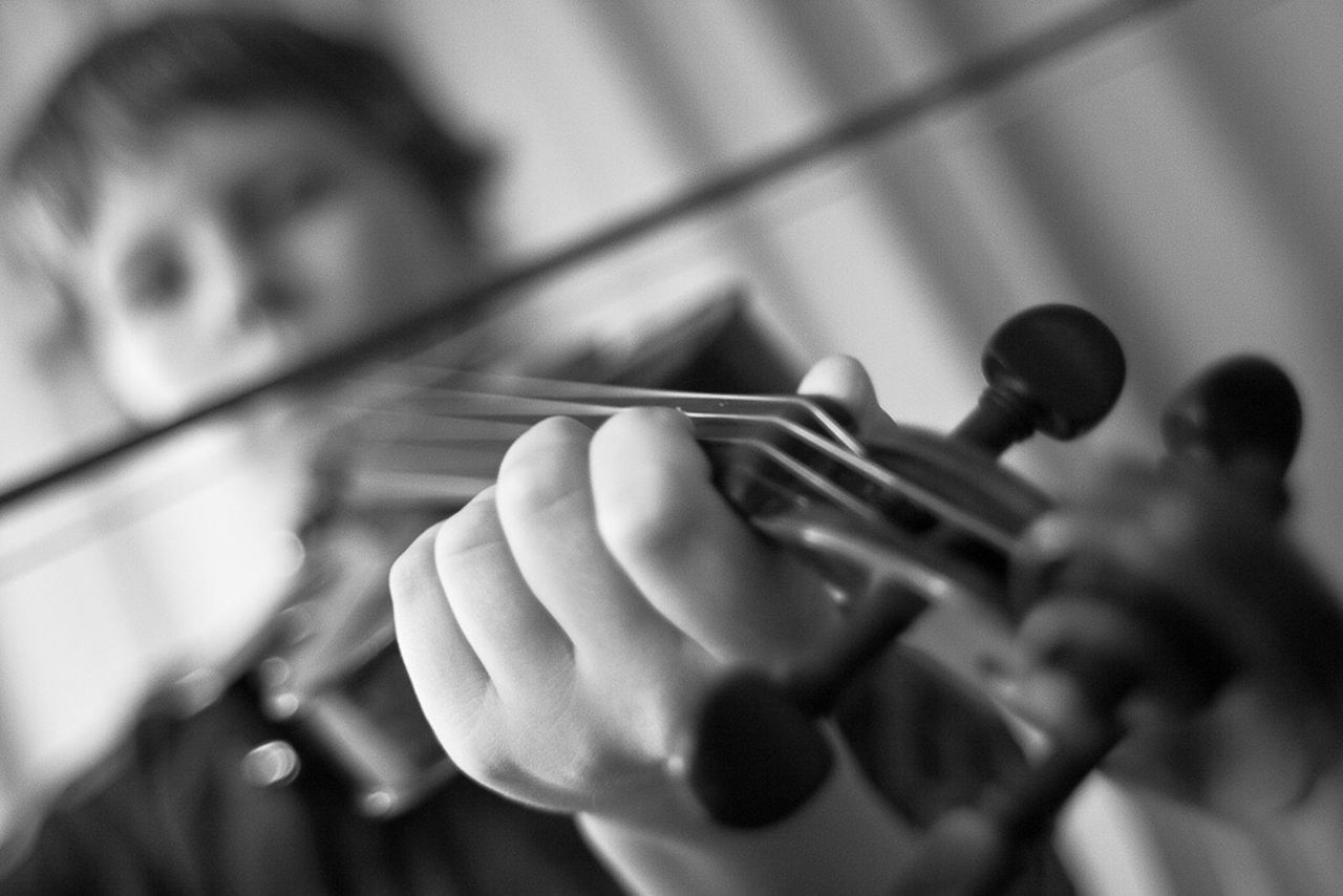 music, playing, musical instrument, real people, musician, indoors, selective focus, human hand, two people, holding, close-up, arts culture and entertainment, men, human body part, musical instrument string, day, classical music, people