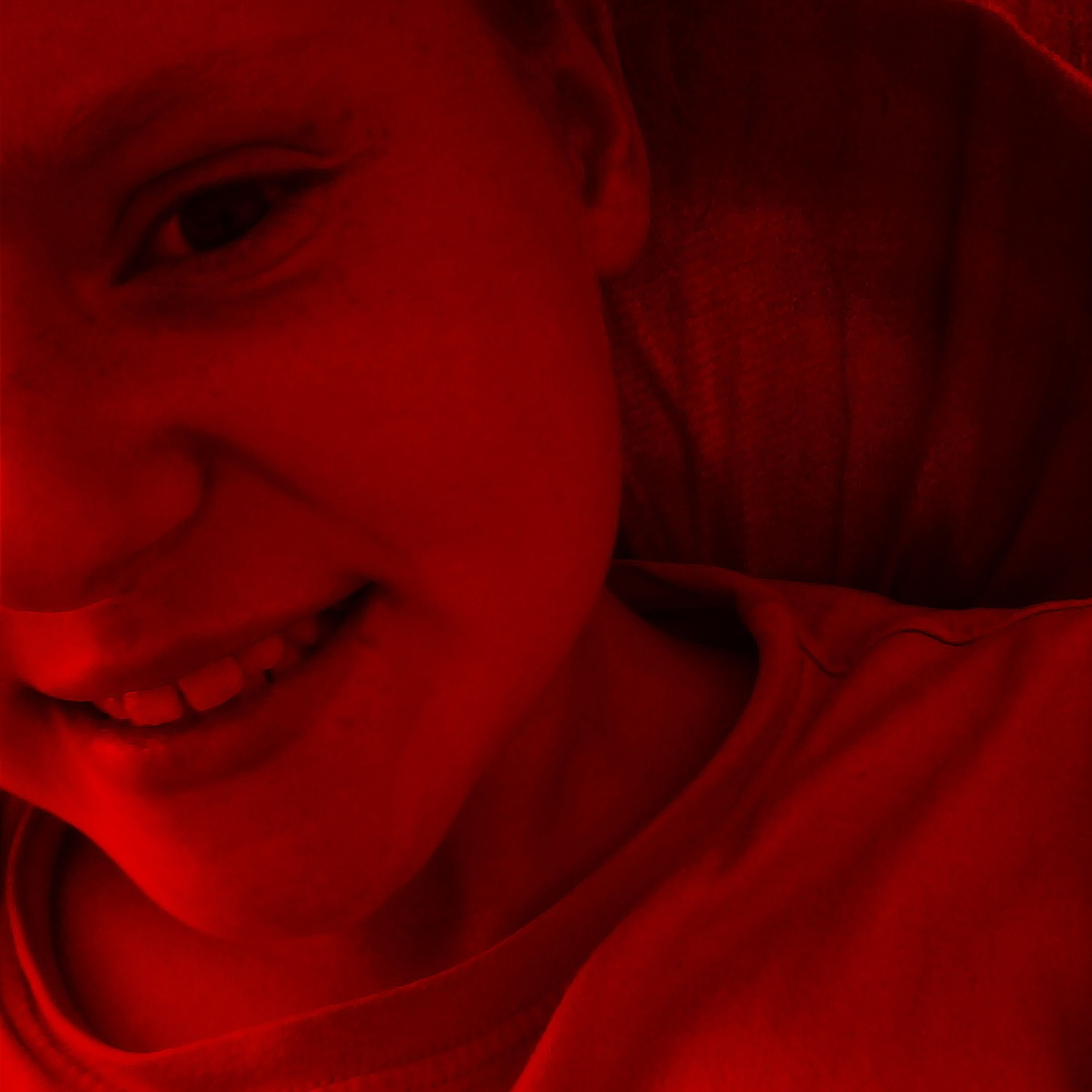 red, indoors, headshot, close-up, young adult, person, domestic life