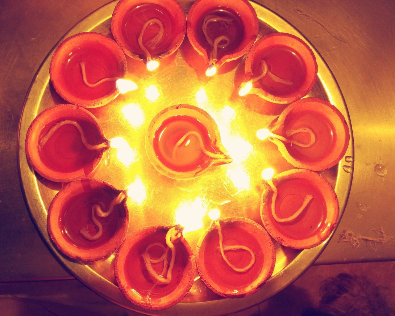 flame, burning, heat - temperature, glowing, no people, indoors, night, illuminated, diya - oil lamp, close-up