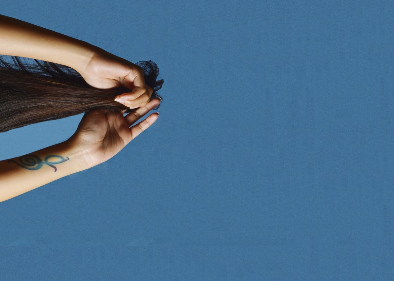 copy space, studio shot, human hand, one person, human body part, real people, women, blue, close-up, day, outdoors, people