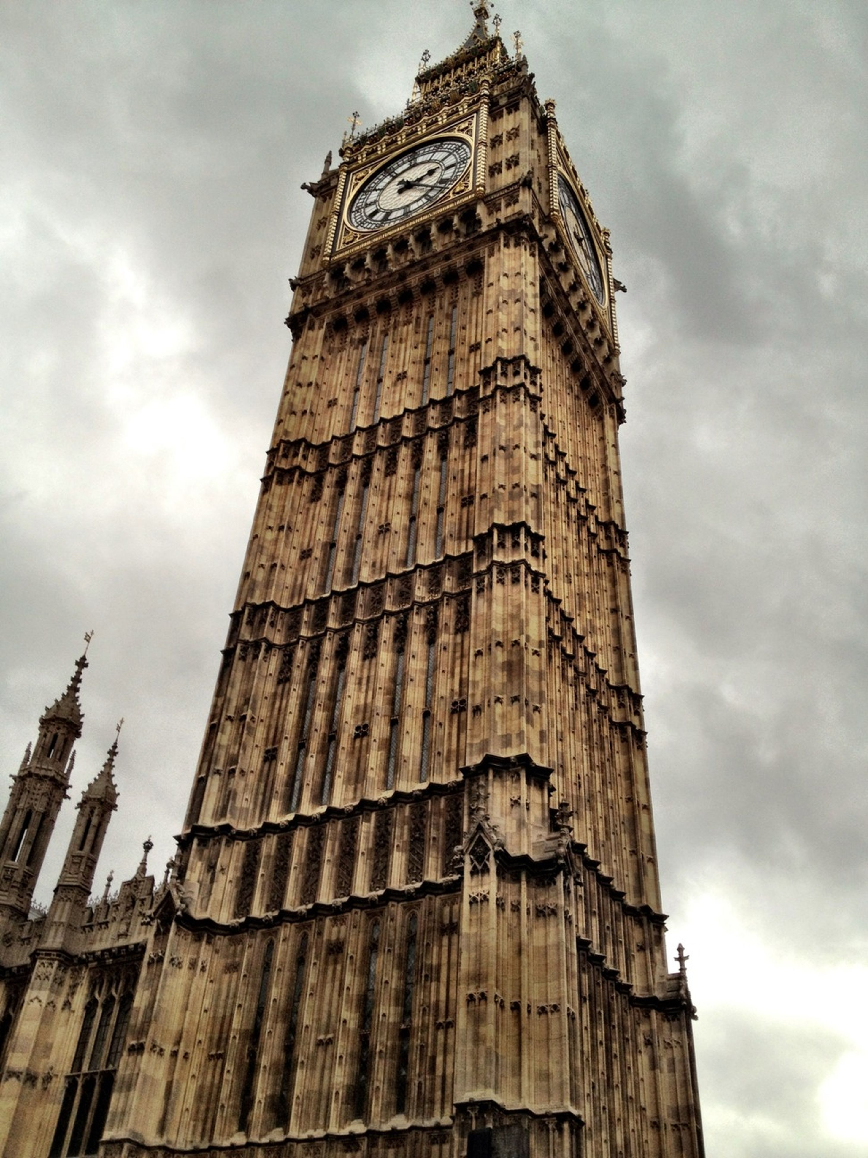 architecture, building exterior, built structure, low angle view, sky, tower, cloud - sky, tall - high, famous place, history, travel destinations, cloudy, city, cloud, clock tower, travel, tourism, capital cities, religion, international landmark