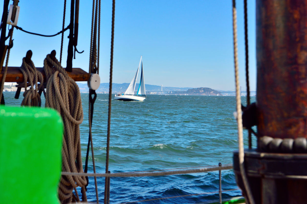 Sailing The Bay 8 Aboard The Alma Boat Deck View Through Ships Rigging San Francisco Bay Bay Bridge Yerba Buena Island Eastbay Hills Sailing Sports Watersports Calm Waters Clear Sky Light Wind Open Sails Perfect Day For Sailing Seascape Seaview