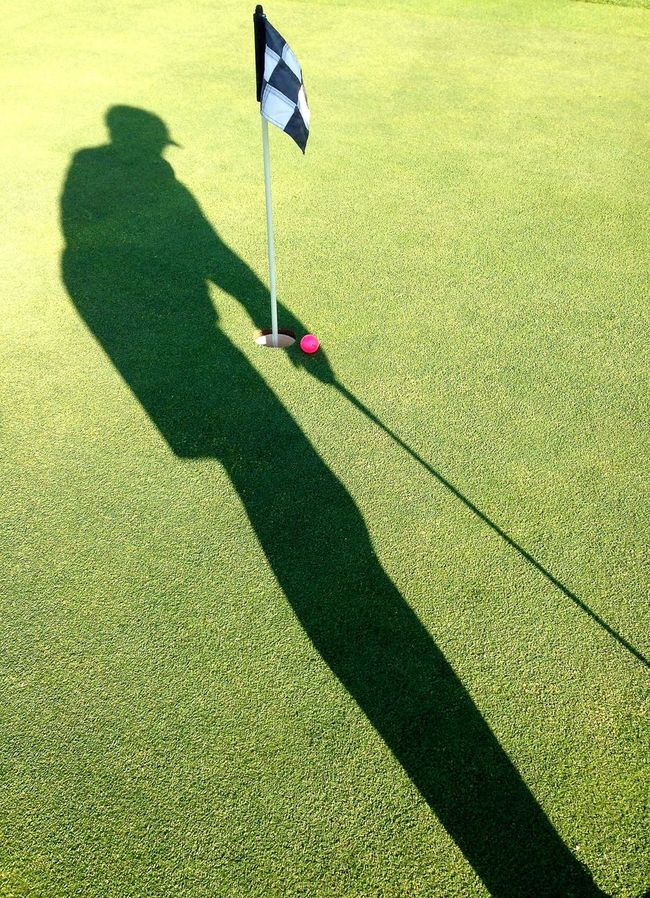 In the Cup! Day Elevated View Exercise Focus On Shadow Golf Golfer Grass Green Color Ground Growth Healthy Lifestyle Leisure Activity Lifestyles Outdoors Pink Color Putting Green Racing Flag Retirement Shadow Sports Sunny Unrecognizable Person