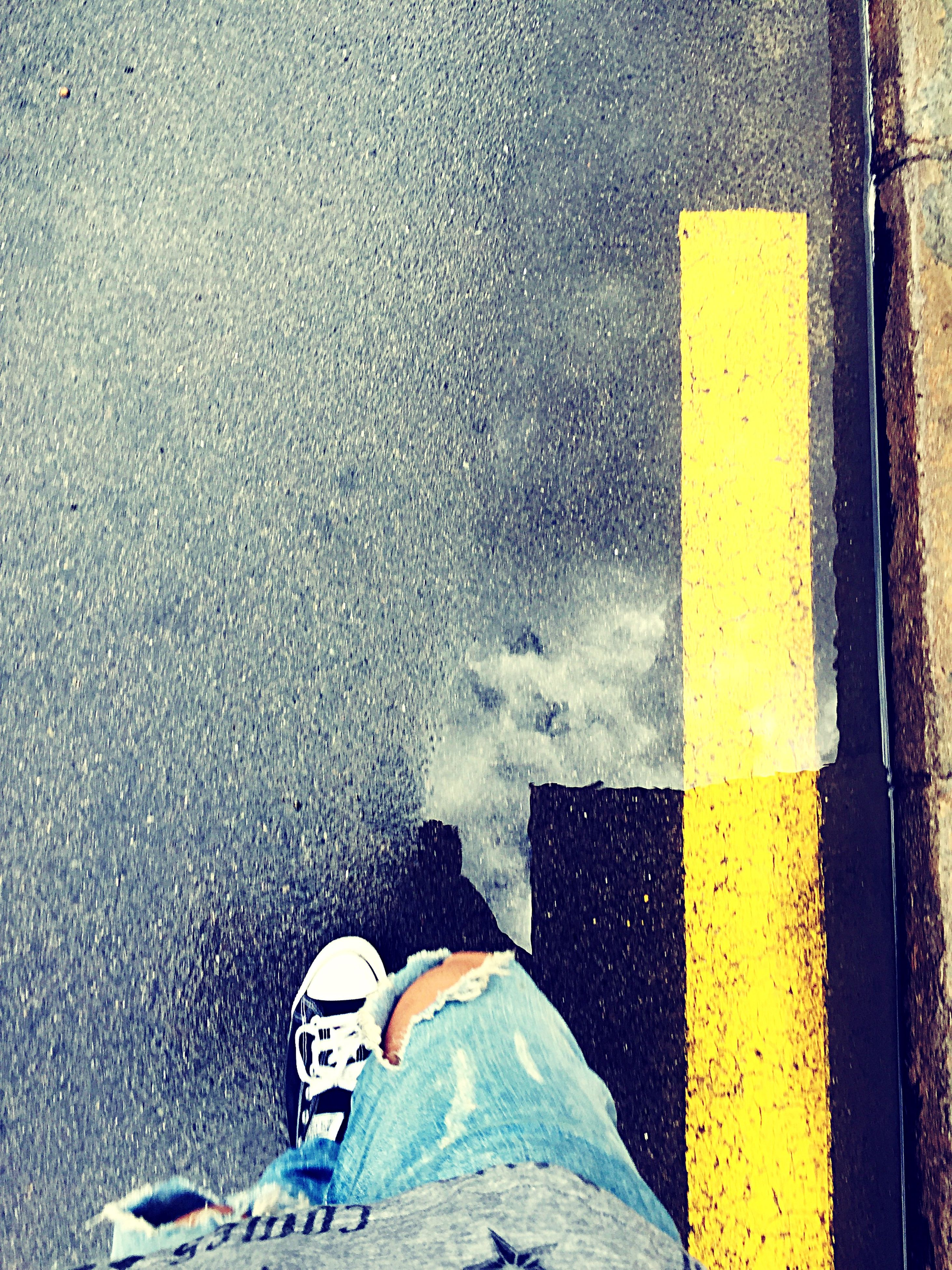 low section, person, shoe, street, personal perspective, yellow, lifestyles, standing, high angle view, transportation, road, men, asphalt, season, wet, human foot, road marking