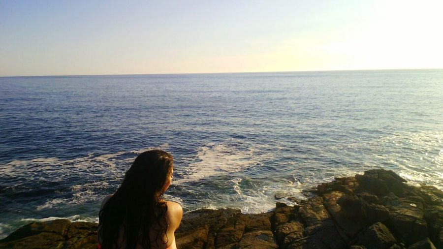 Sea Horizon Over Water Water Scenics Tranquility Tranquil Scene Beauty In Nature Beach Leisure Activity Sunset Rear View Idyllic Vacations Nature Long Hair Getting Away From It All Sky Sunbeam Shore Remote