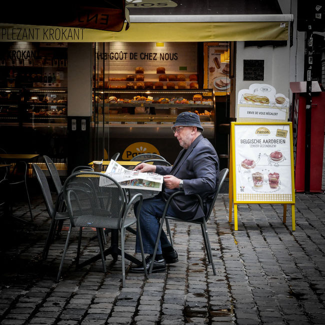 Bakery Breakfast Cafe Casual Clothing City City Life Cobblestone Day Grandpa Leisure Activity Lifestyles Morning Newspaper Old Man Outside Patio Reading Relaxing Shop Square Squaready Squareinstapic Store Street Streetphotography