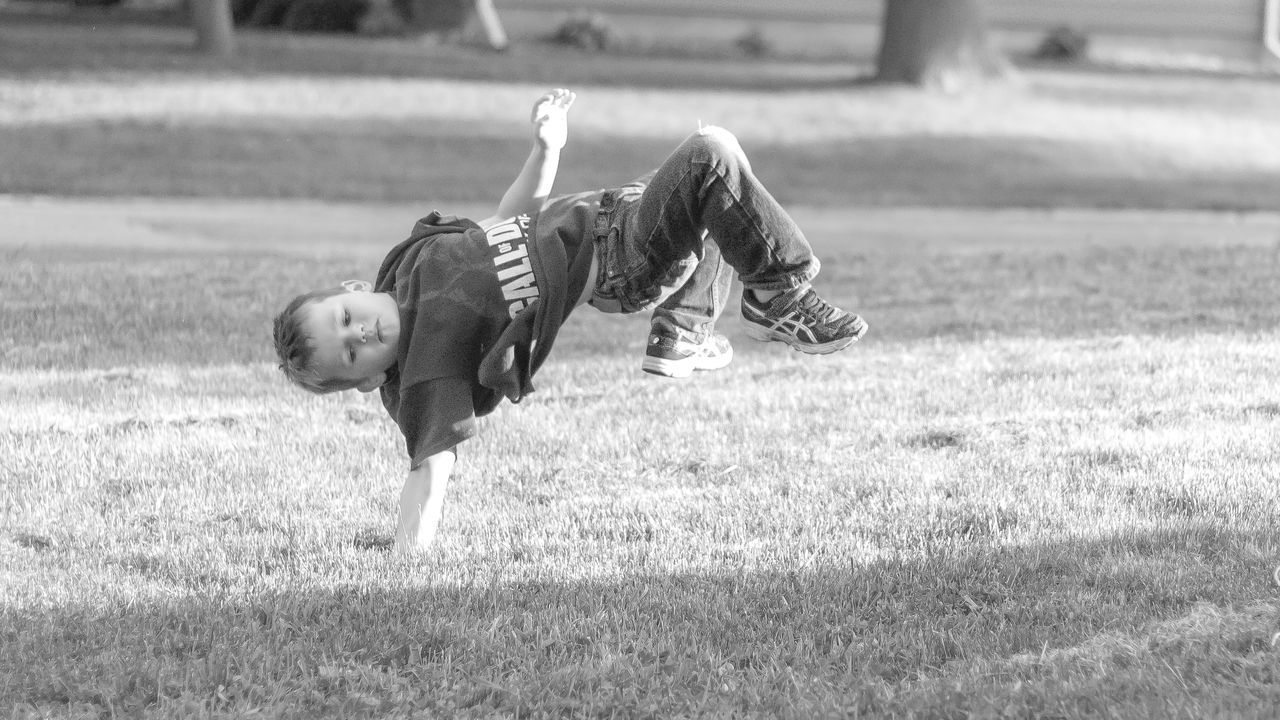 Handstand Blackandwhite Boys Childhood Day Flexibility Full Length Fun Grass Handstand  Happiness Leisure Activity Lifestyles Live For The Story Motion One Person Outdoors People Playing Real People Running