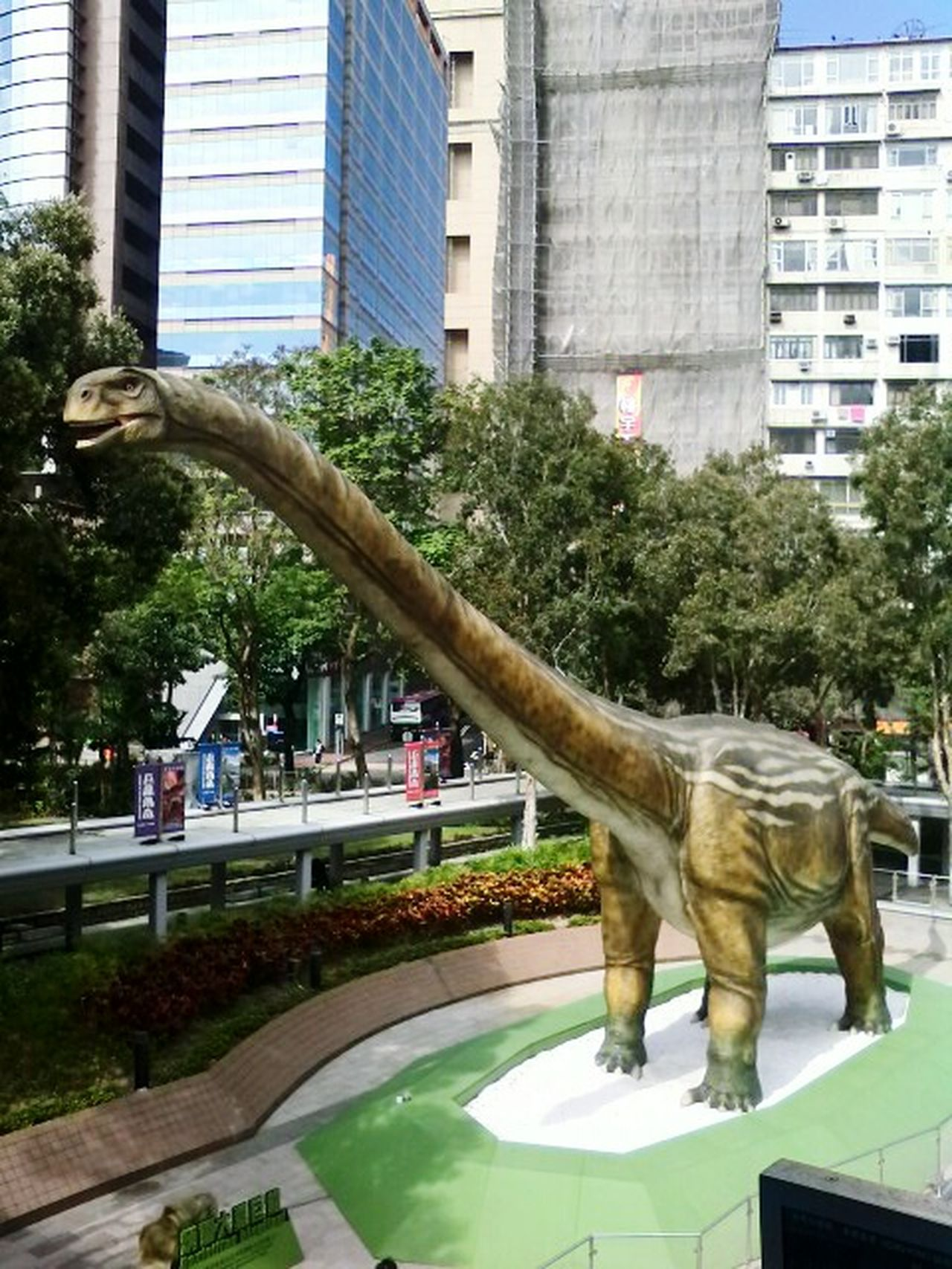 Dinosaur In Town Dinosaur Statue Street Side Park - Man Made Space No People