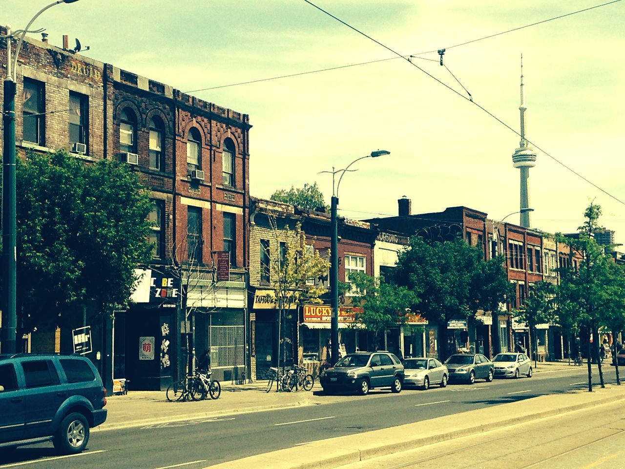 Urban Landscape The Street Photographer - 2015 EyeEm Awards Streetscape CN Tower - Toronto Chinatown Urbanphotography Torontophotographer Commercial Street Local Artist Taking Photos