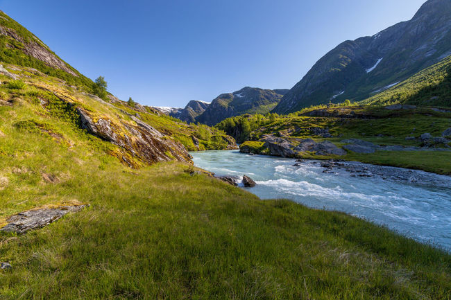 Beauty In Nature Blue Blue Sky Day Exploring Geology Glacier River Green High Angle View Hill Mountain Mountain Range Norway Outdoors Physical Geography River Rock Rock Formation Scenics Tranquil Scene Tranquility Trip On the way to the Austerdalsbreen Landscapes With WhiteWall