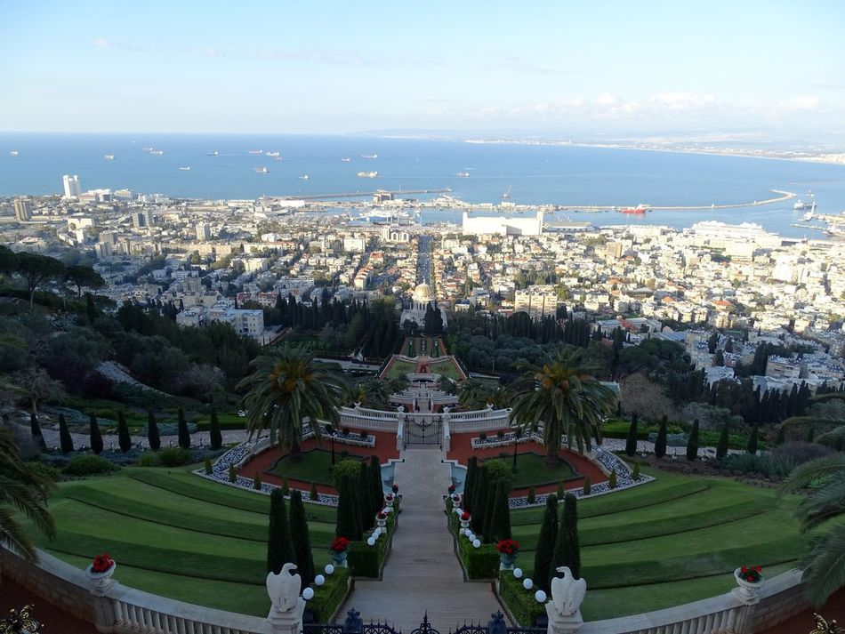 Bahai Gardens in Haifa, Israel seen from above with a view over the gardens onto the port and the Mediterranean Sea Adult Architecture City Cityscape Day Large Group Of People Nature Outdoors People Sky Haifa Israel Haifa HaifaBay Mount Carmel Palm Tree Urban Skyline Religion Dome Bahai Gardens Bahaigardens Bahai Temple Bahaism Bahai Religion Bahai Bahai_shrine
