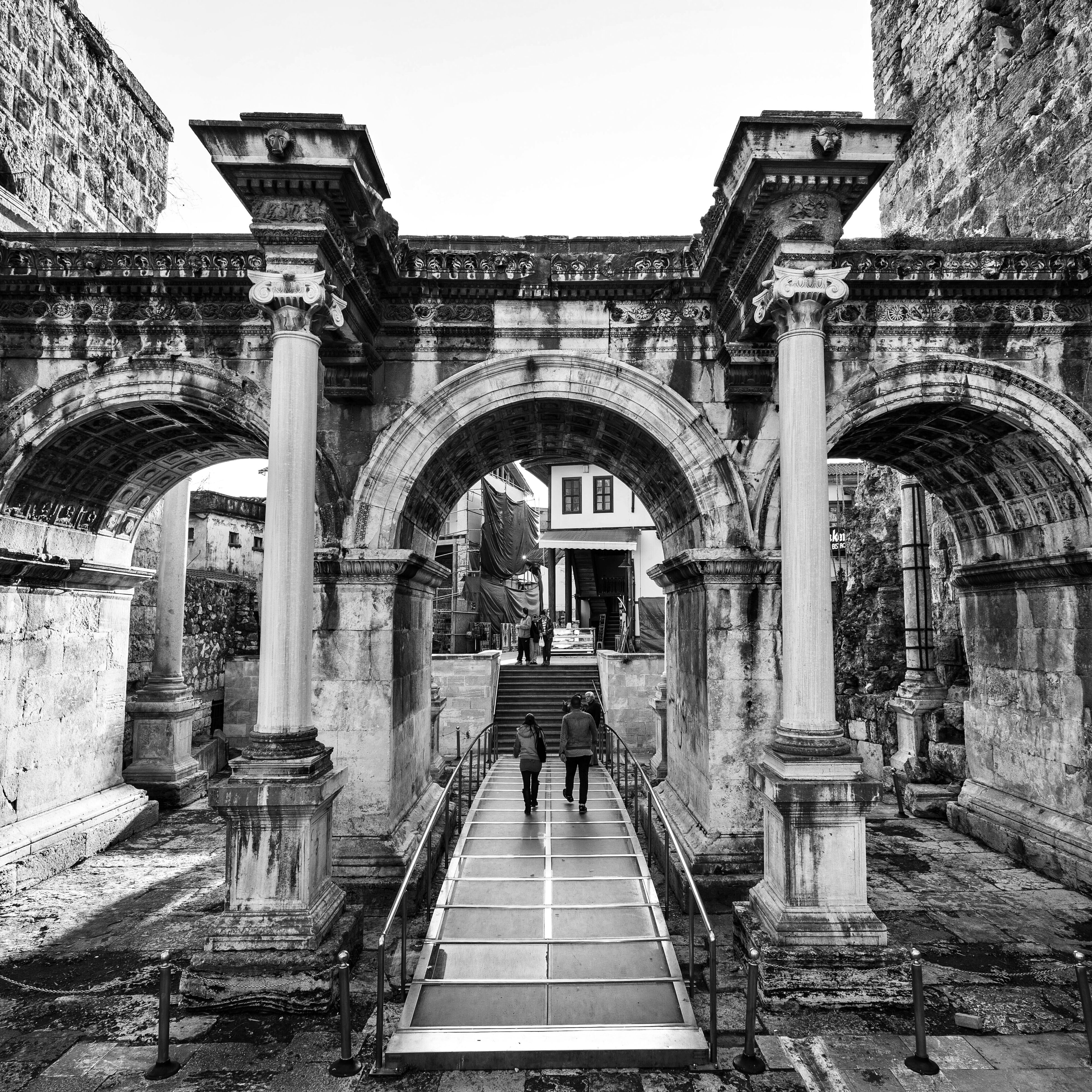 architecture, built structure, arch, building exterior, steps, entrance, railing, architectural column, history, low angle view, religion, clear sky, day, place of worship, archway, gate, the way forward, outdoors, steps and staircases, old