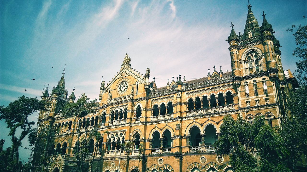 Previously known as Victoria Terminus, now the great architecture stands as Chhatrapati Shivaji Terminus in Central Mumbai. A place always bustling with hoards of people from all over Mumbai. It is the headquarters of Central Railway and a must visit for its ancient British Architecture!The Architect - 2017 EyeEm Awards Sky Cloud - Sky Low Angle View Outdoors Day No People Architecture Building Exterior Nature Pixelated EyeEm Best Shots BYOPaper! The Great Outdoors - 2017 EyeEm Awards The Street Photographer - 2017 EyeEm Awards EyeEmNewHere Travel Cityscape