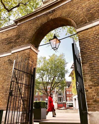 EyeEm LOST IN London Architecture Building Exterior Built Structure One Person Only Women One Woman Only Low Angle View Adult Adults Only Day Red Jacket Outdoors Full Length Travel Destinations Women City London London Lifestyle