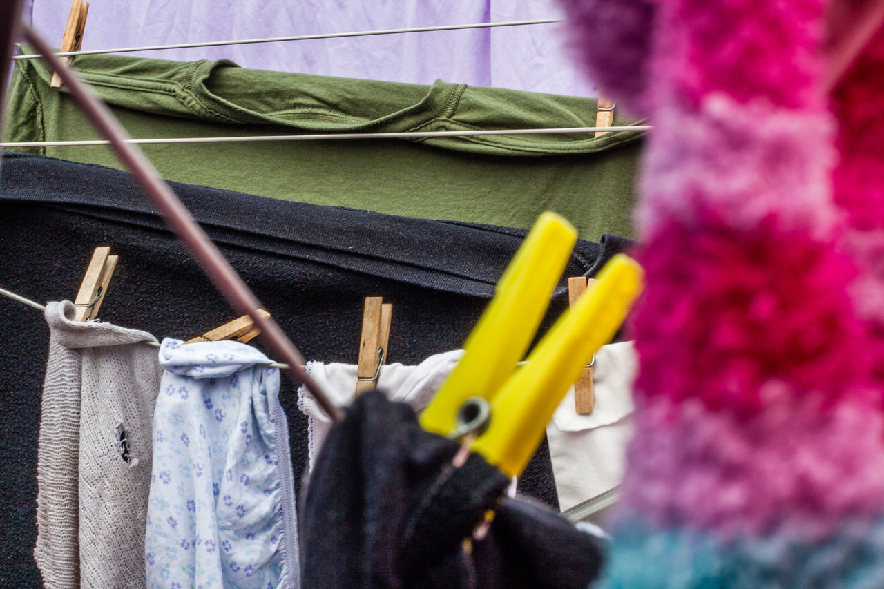 Blue Close-up Clothes Day Domestic Chores Drying Focus On Foreground Green Color Hanging Multi Colored No People Outdoors Part Of Pegs Selective Focus Textile Washing Washing Line Yellow