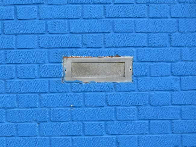 Blue Close-up Stone Material Full Frame No People Building Exterior Outdoors Vibrant Color EyeEm Best Shots - Architecture Brick Work Bricks Brick Brick Wall Wall - Building Feature Conformity Letterbox Letter Box Whale Brickwork  Patterned Extreme Close-up Freshness ContrastsDetail in Great Britain