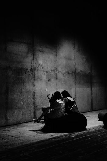 2 Women Ambiance Architecture Architecture_collection Dark Deterioration Enlightened Illuminated Lifestyles Mothers Portrait Of A Woman Sitting Sitting Taking Photos The Architect - 2016 EyeEm Awards The Portraitist - 2016 EyeEm Awards The Street Photographer - 2016 EyeEm Awards Waiting The Photojournalist - 2016 EyeEm Awards People Together Monochrome Photography