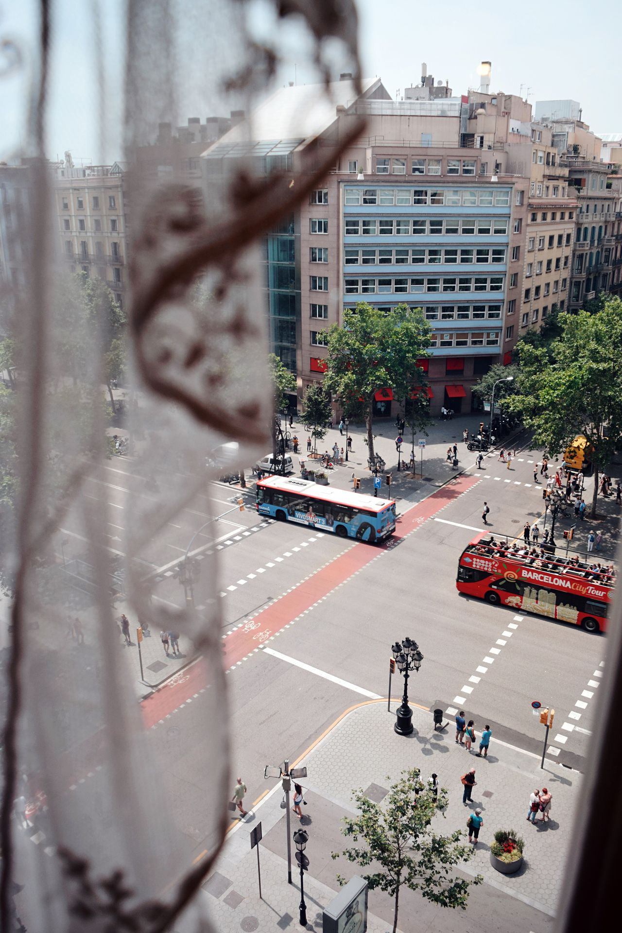 Barcelona Architecture Building Exterior Built Structure City Car Street Road City Street Transportation Mode Of Transport Tree Land Vehicle City Life Day Large Group Of People Outdoors Real People People Traffic Bus Curtain Romantic
