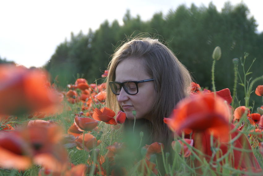 Beautiful Woman Beauty In Nature Close-up Day Eyeglasses  Flower Fragility Freshness Front View Growth Happy Girl  Leisure Activity Lifestyles Nature One Person Outdoors Plant Poppy Fields Real People Red Selective Focus Summer Tree Young Adult Young Women