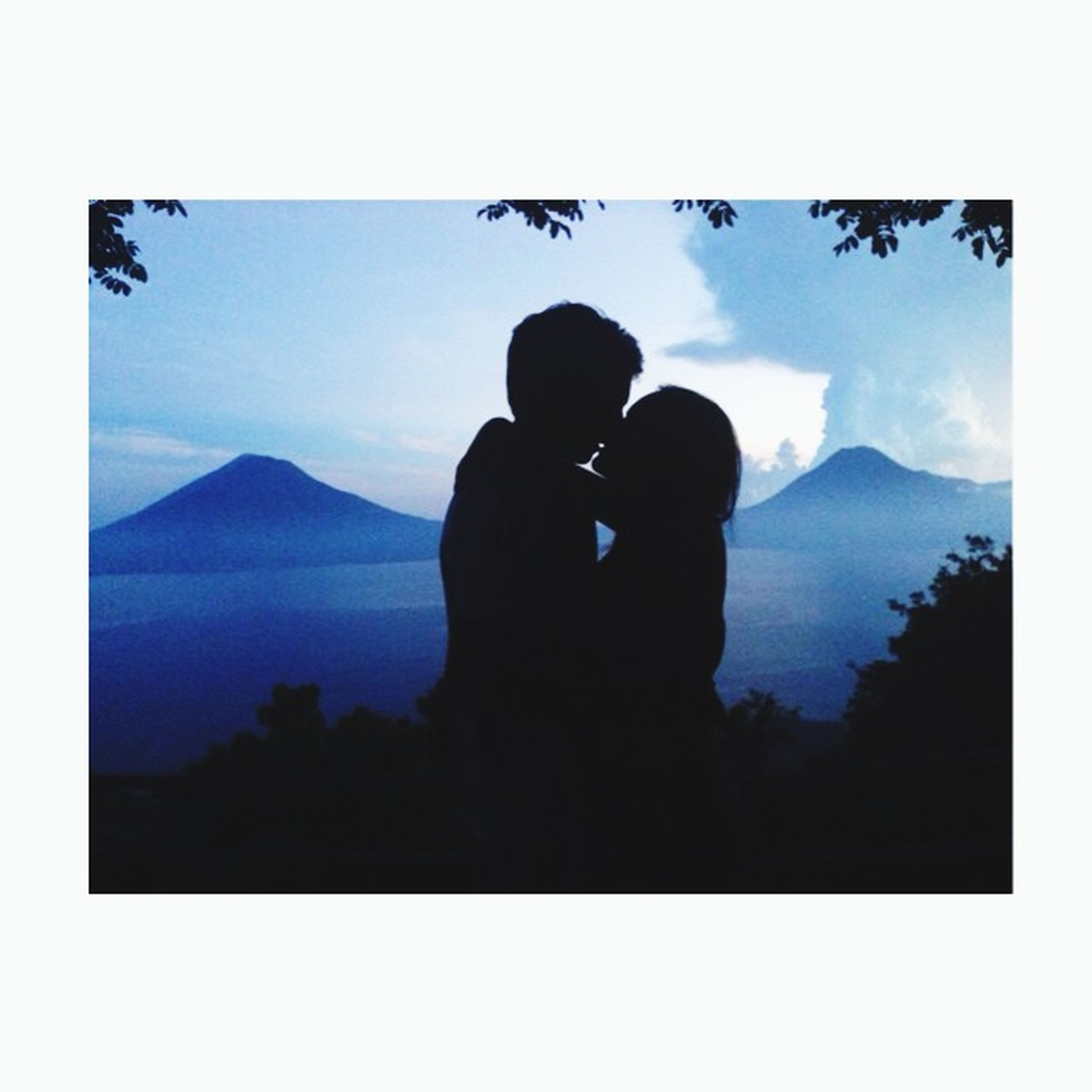 silhouette, lifestyles, mountain, sky, leisure activity, rear view, men, standing, togetherness, tranquility, nature, tranquil scene, transfer print, beauty in nature, scenics, full length, three quarter length