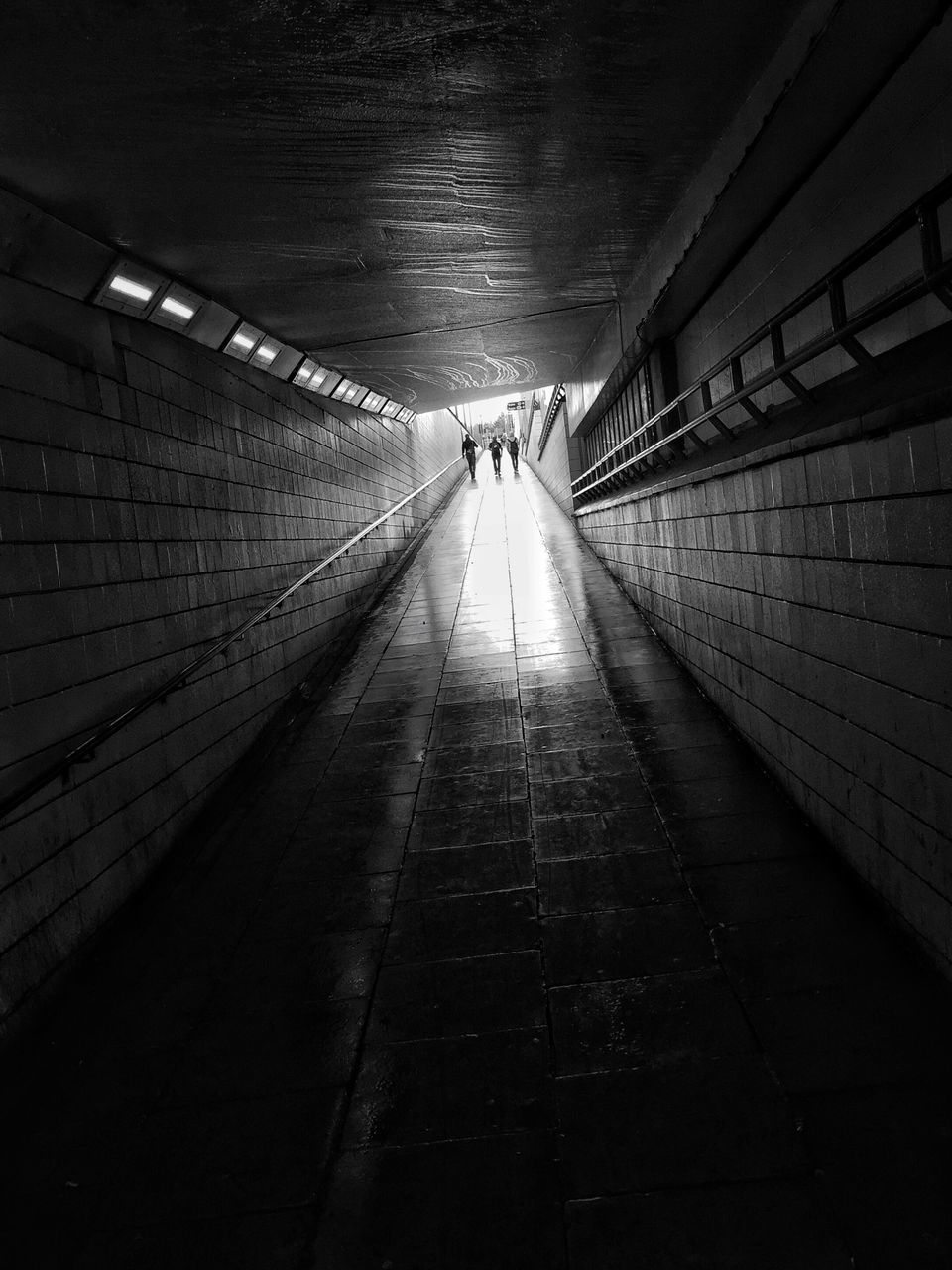 real people, the way forward, two people, full length, indoors, walking, tunnel, built structure, women, architecture, illuminated, men, walkway, togetherness, day, people