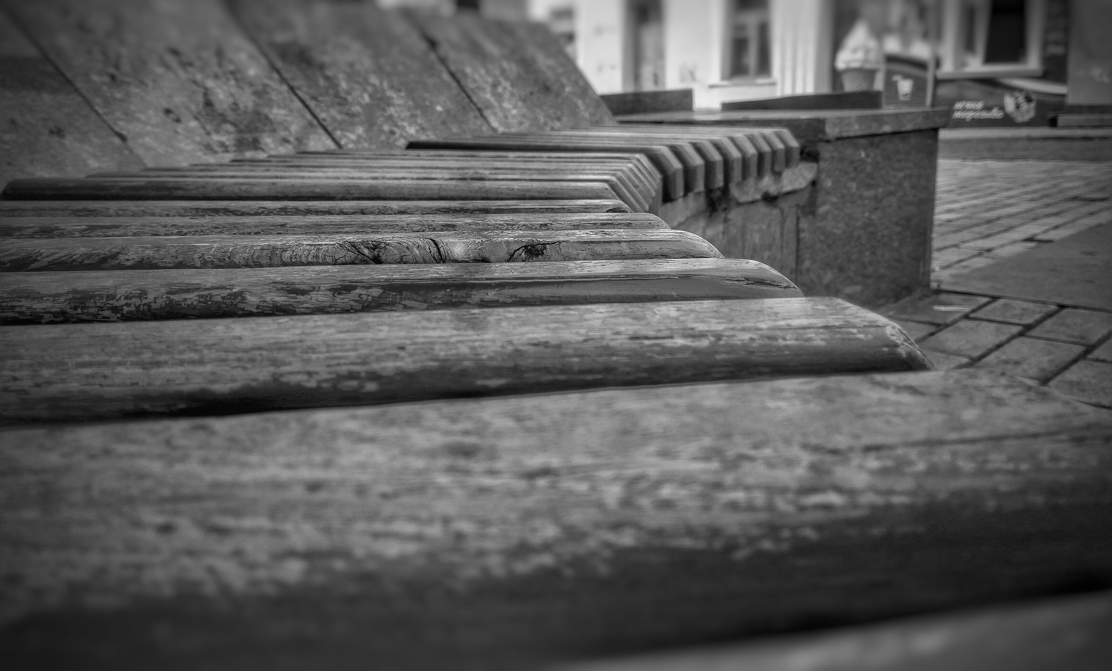 wood - material, wooden, selective focus, surface level, close-up, focus on foreground, wood, plank, bench, steps, built structure, boardwalk, day, outdoors, textured, no people, sunlight, railing, empty, table