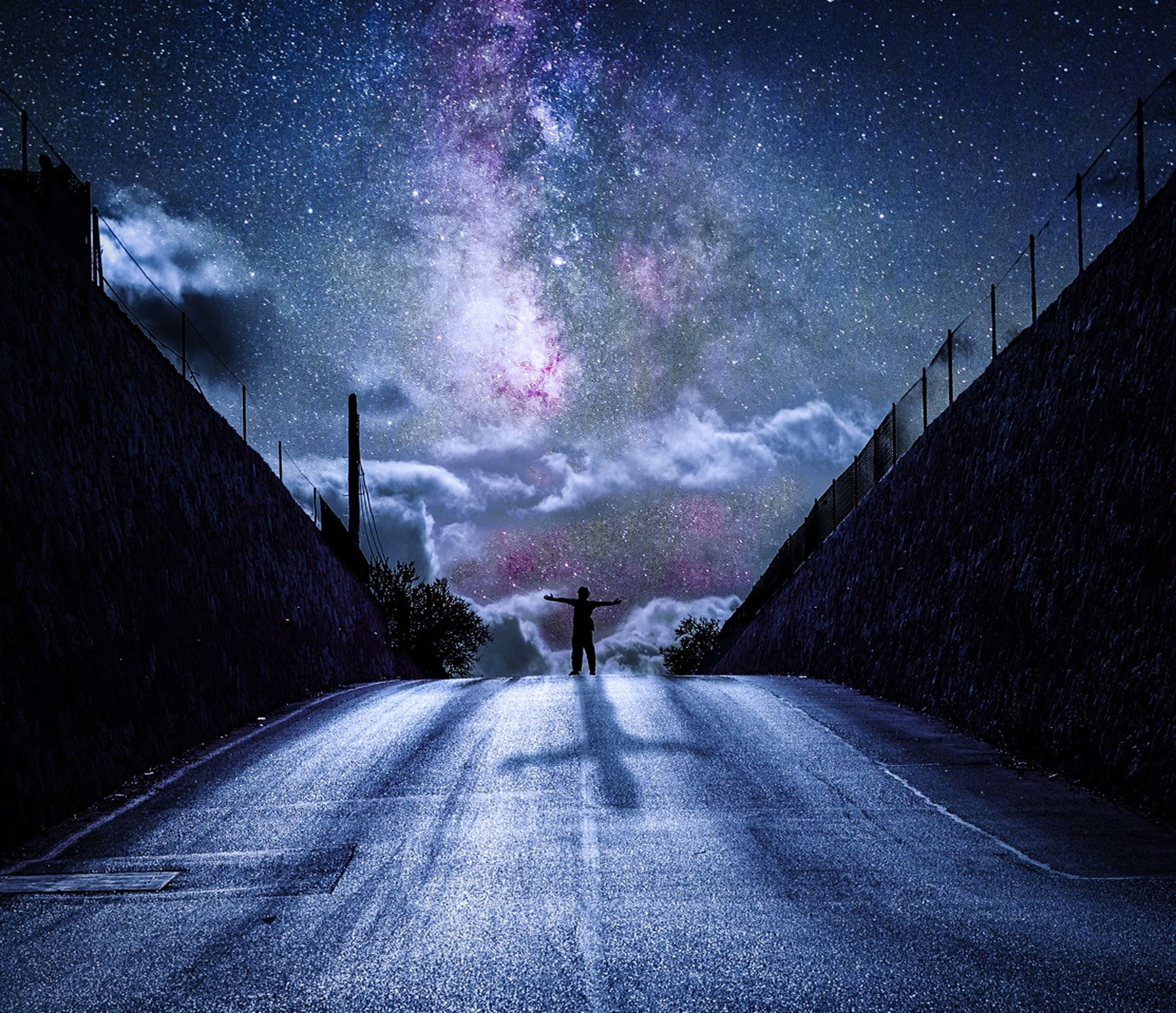 the way forward, night, sky, road, diminishing perspective, illuminated, street, weather, vanishing point, street light, cloud - sky, lifestyles, silhouette, rear view, walking, men, unrecognizable person, dusk