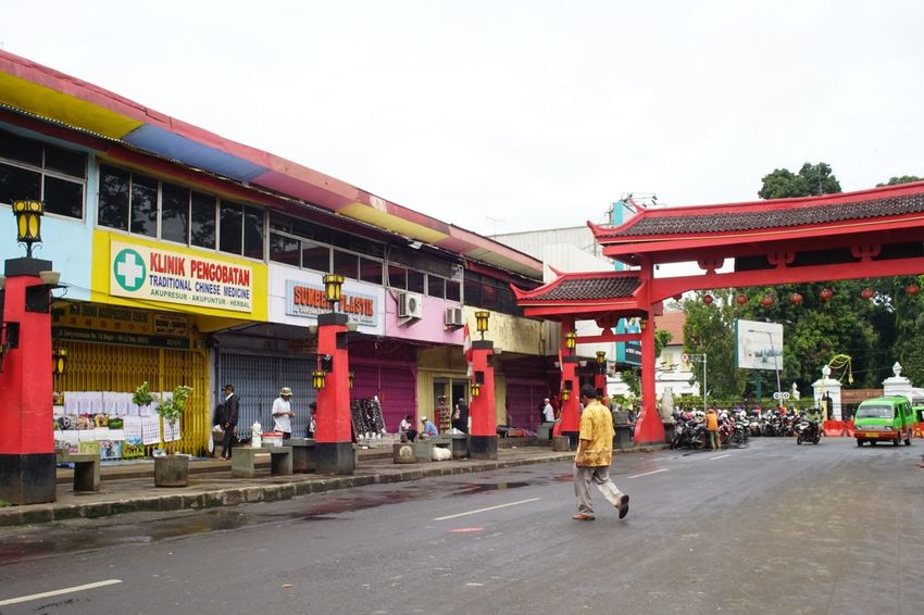 Bogor China town. Street Photography Street Bogor, Indonesia Old Town Street Capture Photography By @jgawibowo Arif Wibowo Photoworks Shot By @jgawibowo Shot By Arif Wibowo Business Finance And Industry Architecture Day Outdoors Full Length Building Exterior People