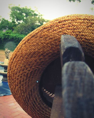 Sunmer hat Water Outdoors Day No People Simplicity Red Brick Wooden Texture Straw Hat Close Up Rainy Days☔ Happiness EyeEmNewHere Eyecatcher Port Elizabeth Windy City Bright Colors Close-up