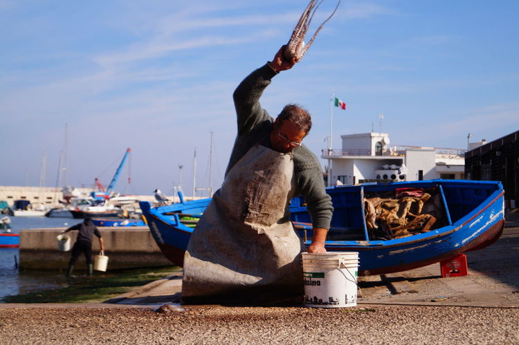 #Blue #boat #chiringuito #colours #Fisherman #octopus #Pugliacolours #red #sea #sky #spring #sun #Work Harbor Outdoors EyeEmNewHere