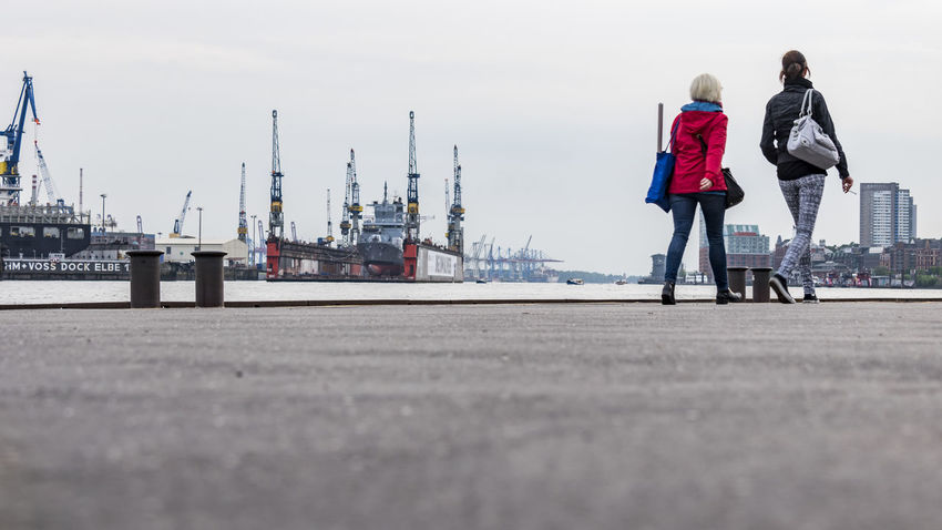 two woman Blohm + Voss Day Docks Elbe River Full Length Harbor Industry Landungsbrücken, Hamburg Men Outdoors People Real People Sky Smoker St. Pauli Two People Two Woman Water Women