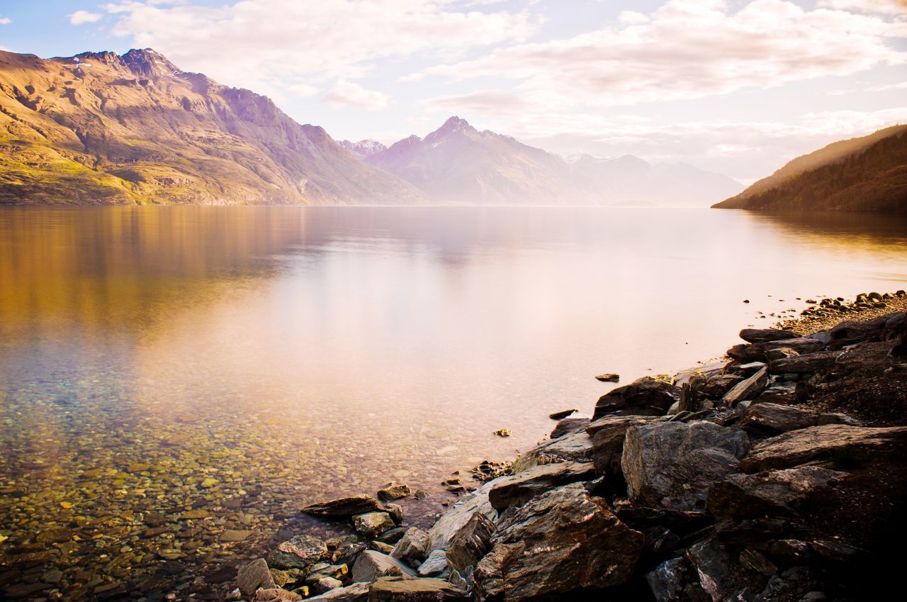 Lake Wakatipu Tourist Attraction  Queenstown New Zealand Calm Lake Still Reflection Shore Lakeside