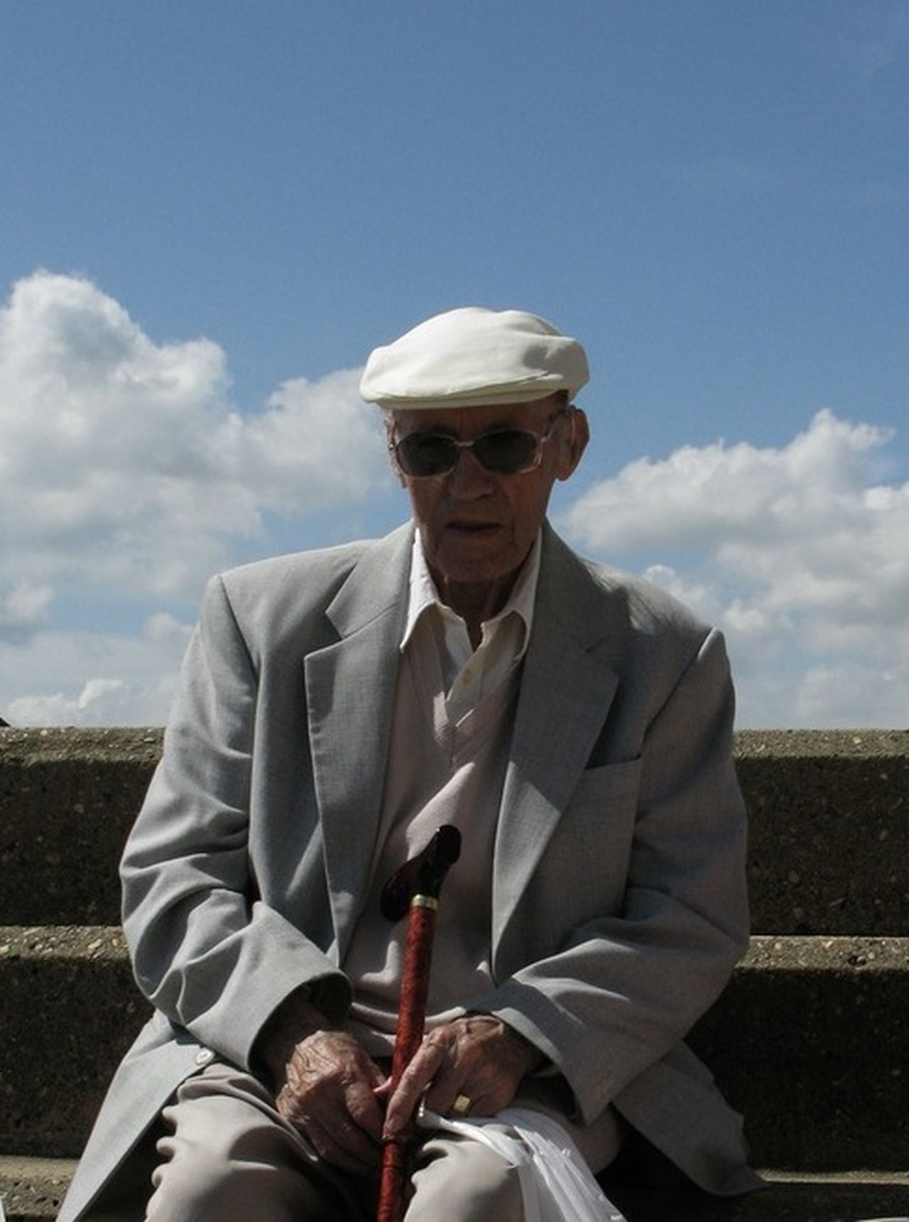 Alone Business Businessman Confidence  Friendship Front View Full Length Grandpa At The Beach In The Sun Holding Lifestyles Person Perspective Portrait Real People Standing The British At The Seaside On Holiday Kids Children Two 2 Girls On Jetty Watch Dingy Deep In Thought Seaside Jetty Water Wake Dingy Orange Sand Coastline Suffolk Horizon Documentary Reportage Photography Taking Shots Colour Color Dresses From My Point Of  The British On Holiday By The Seaside Waves White Crest Foam Sea Ocean Beach Sand Bathing Trunks Crocks Thinking Deep Thoughts Contemplation Man Male White Pale Lonly Looking Figure Sad Sadness Documentary Reportage Photography Photograph Photographer Col Three Quarter Length Togetherness Well-dressed Young Adult Young Men