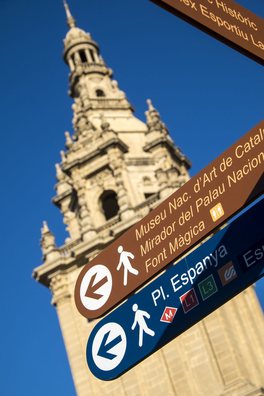 Low Angle View Of Information Sign Against Blue Sky
