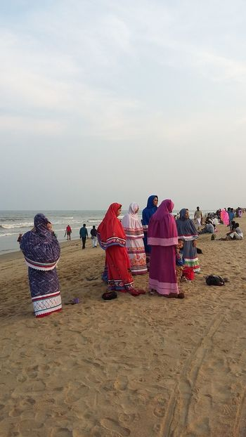Baji at the Beach - Muslim ladies enjoy an evening at Elliots Beach in Chennai dressed in colourful traditional muslim clothing. Beach Beach Life Burka  Colourful Day Enjoyment Horizon Over Water Horse India Ladies Large Group Of People Leisure Activity Lifestyles Muslim Outdoors People Of The Oceans Scenics Sea Shore Sky Tourism Tourist Traditional Clothing Vacations