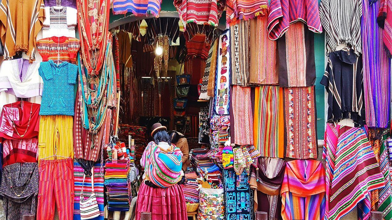 Hanging Variation Retail  Choice Multi Colored Clothing Fashion Store For Sale Full Frame Cholita Aymara Aymara Woman Local Outdoors La Paz, Bolivia City