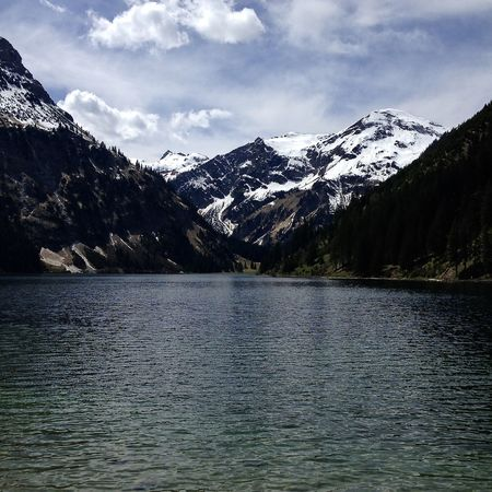 spring in the alps, lake and snowcapped mountain Alps Amazing Beauty In Nature Clouds Colors Holiday Lake Landscape Light Mountain Nature Outdoors Reflection Scenics Sky Snow Snowcapped Mountain Spring Tannheimer Tal Tirol  Tranquil Scene Travel Vilsalpsee Water Wilderness