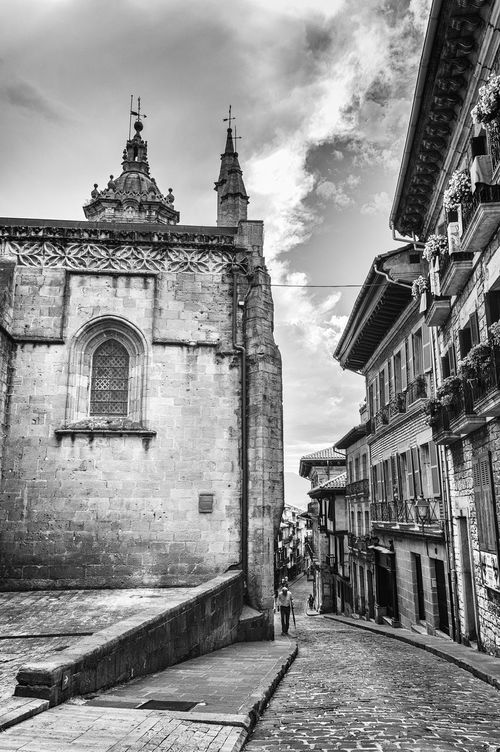 Street in european historical city centre Architecture Building Exterior Built Structure Church Cloud - Sky Day Façade Footpath Hanging Out Historic History Hondarribia Long Medieval Narrow No People Outdoors Pedestran Place Of Worship Sky Stone Stone Material The Way Forward