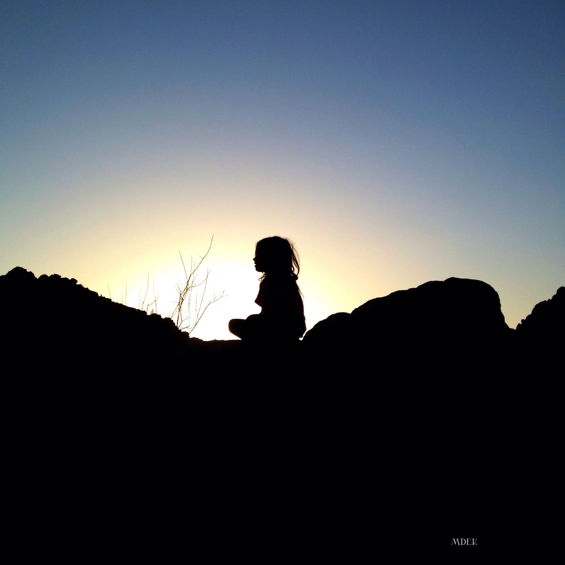 silhouette, copy space, clear sky, sunset, leisure activity, lifestyles, men, mountain, tranquility, scenics, beauty in nature, tranquil scene, nature, standing, outline, sky, dusk, unrecognizable person