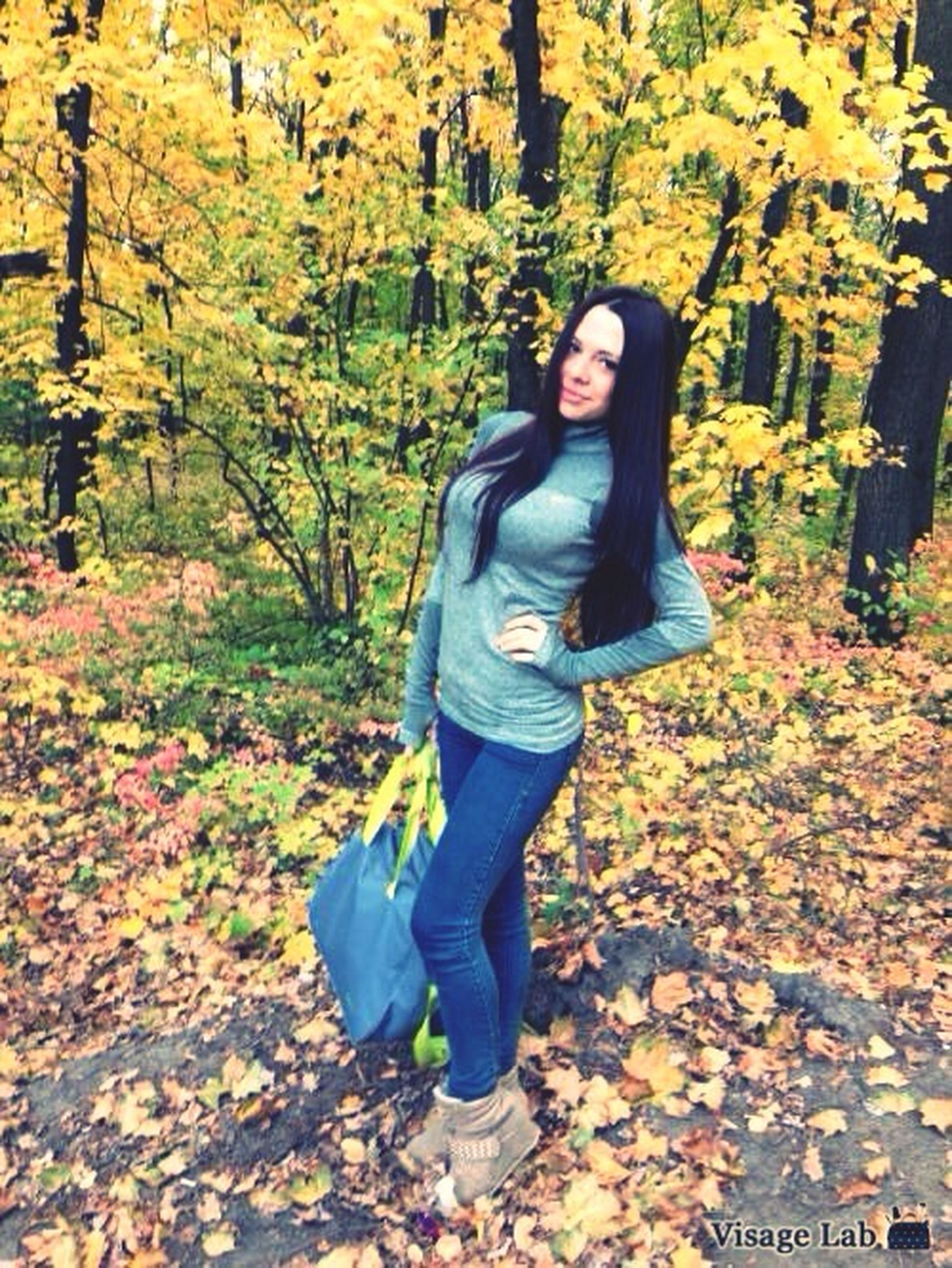 lifestyles, casual clothing, young adult, autumn, leisure activity, person, tree, leaf, full length, standing, change, young women, season, front view, looking at camera, portrait, sitting, three quarter length