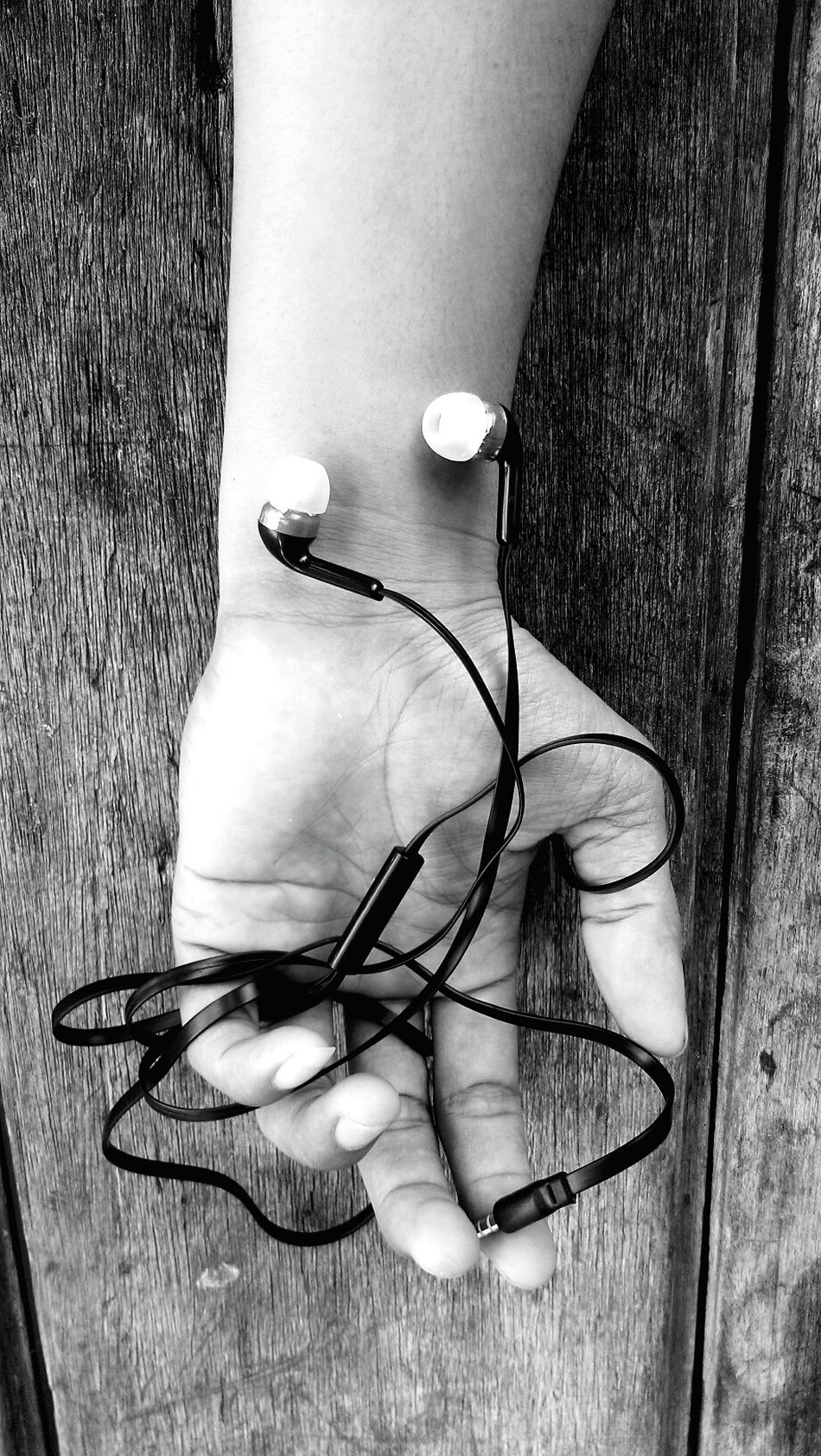 Earphones My Hand  Blackandwhite Photography Black & White Close-up Everyday Emotion Sound Of Silence Sound Of Life TakeoverMusic The Week On Eyem Left HTC_photography EyeEmNewHere Urbanphotography Welcome To Black