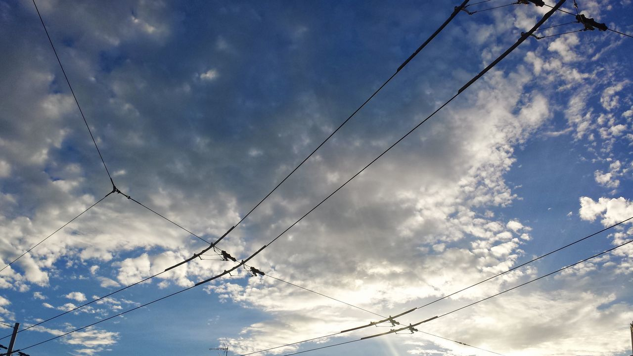 cable, power line, low angle view, sky, cloud - sky, power supply, connection, electricity, no people, outdoors, nature, day, fuel and power generation, telephone line, beauty in nature, electricity pylon, technology, vapor trail