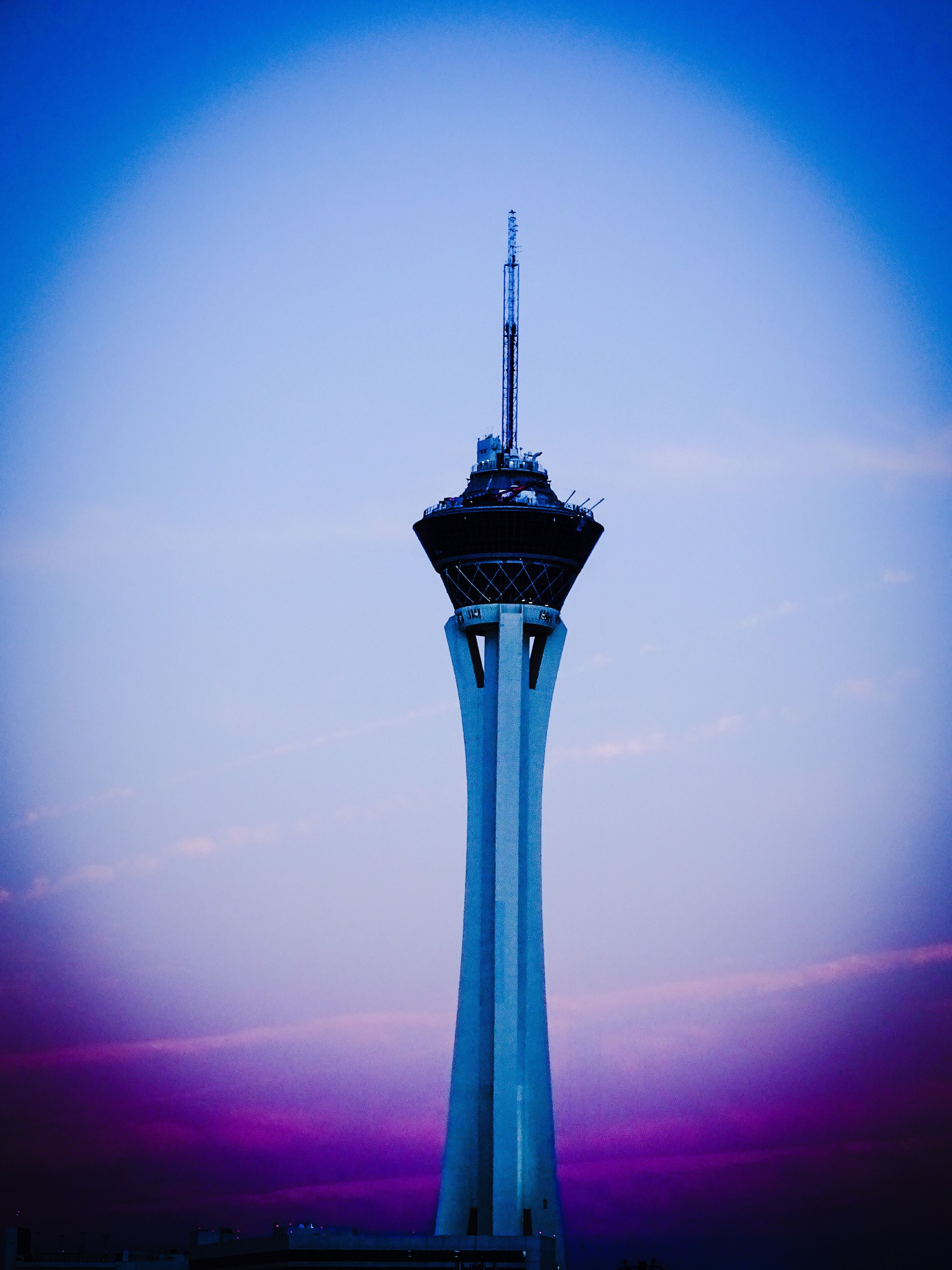 blue, low angle view, clear sky, built structure, copy space, dusk, illuminated, architecture, sky, tower, travel, no people, outdoors, tall - high, travel destinations, lighting equipment, metal, red, connection, night