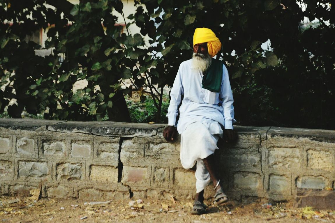 An old man lostbin thought India Village Thinking Lostinthought Mindfullness Colours Sitting Old-fashioned Old Fashion Fashion Forever Villagefashion Yellow Green Alone Time Single Object Lostsouls The Street Photographer - 2016 EyeEm Awards The Portraitist - 2016 EyeEm Awards Fashion
