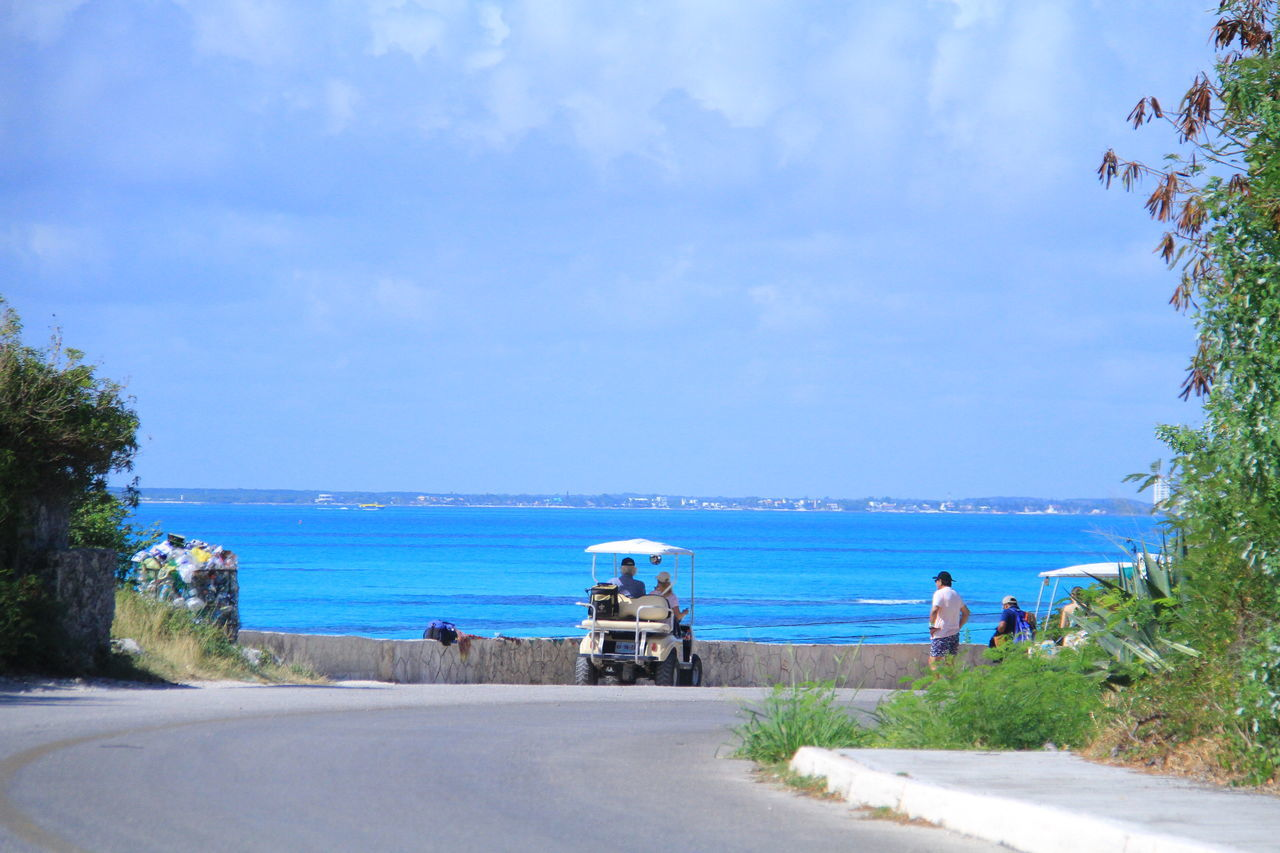 Beach Beauty In Nature Day Horizon Over Water Isla Mujeres Isla Mujeres Cancun Isla Mujeres Mexico IslaMujeres Men Mode Of Transport Nature Nautical Vessel Outdoors Palm Tree Real People Road Scenics Sea Sky The Way Forward Transportation Tree Water
