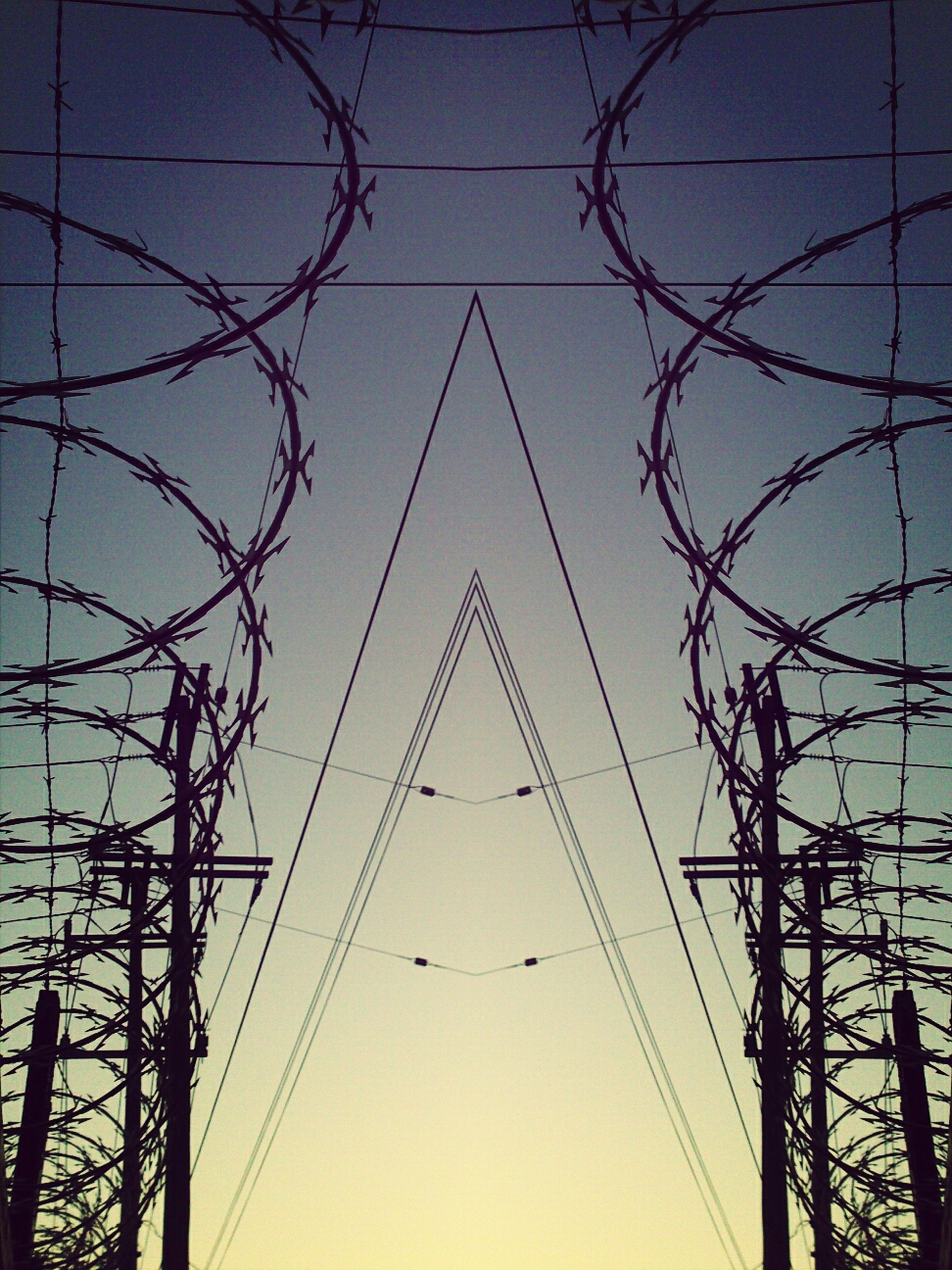 power line, electricity pylon, electricity, connection, power supply, low angle view, cable, fuel and power generation, technology, blue, sky, silhouette, power cable, clear sky, dusk, outdoors, built structure, no people, sunset, complexity