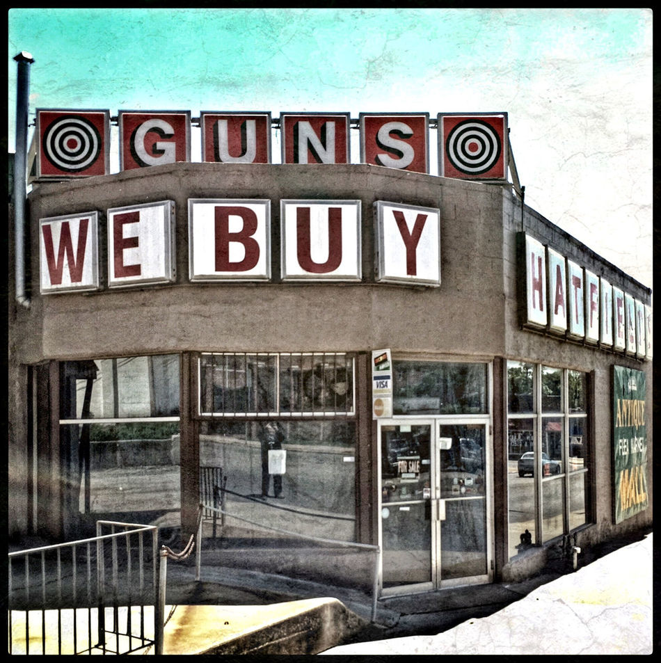 GUNS ARE US ~ Saint Joseph, Missouri USA ~ MIDWESTERN SERENADE Dreamscapes & Memories Landscape Dreamscapes Life Is A Mirror And Will Reflect Back To The Thinker What He Thinks Into It -Ernest Holmes Relic From The Past Saint Joseph, Missouri Divelandscape, Divestreetoghrophy, Cityscape, Roadside America Gunshop Urban Landscape